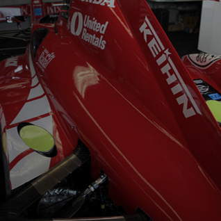 a red Keihin sponsored racecar